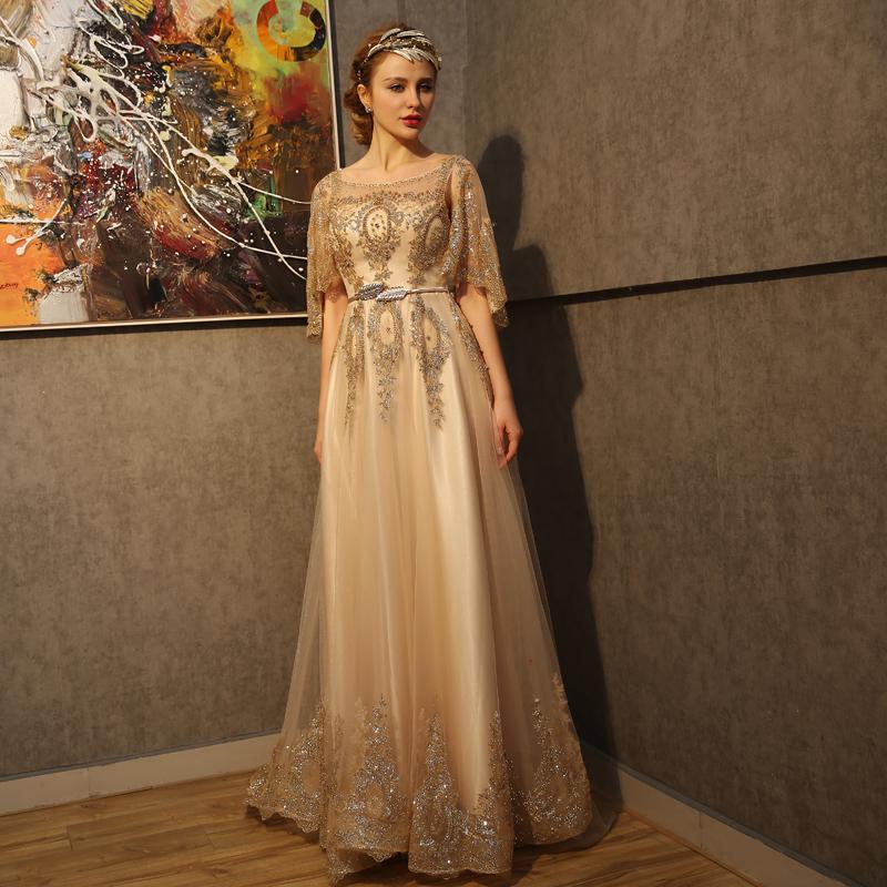 صورة فساتين سهره ذهبي , تصميمات مختلفة لفساتين سهرة ذهبية