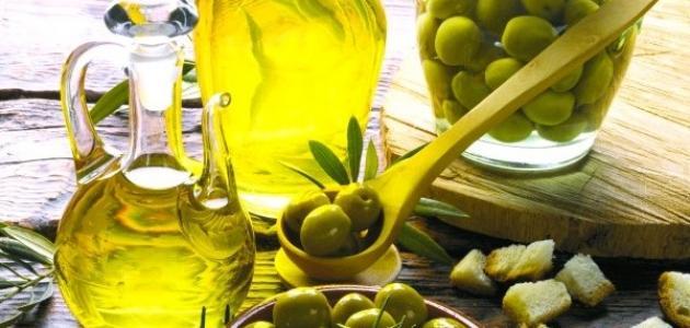 صورة فوائد زيت الزيتون والثوم للشعر , زيت الزيتون والثوم للشعر الخفيف مجرب ونتيجه فعاله